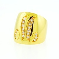 custom gold ring with an M on it