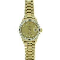 gold diamond watch on display