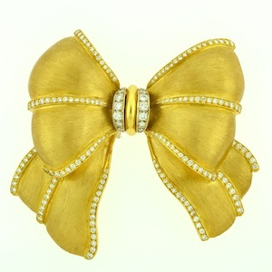 antique jewelry in the shape of a bow